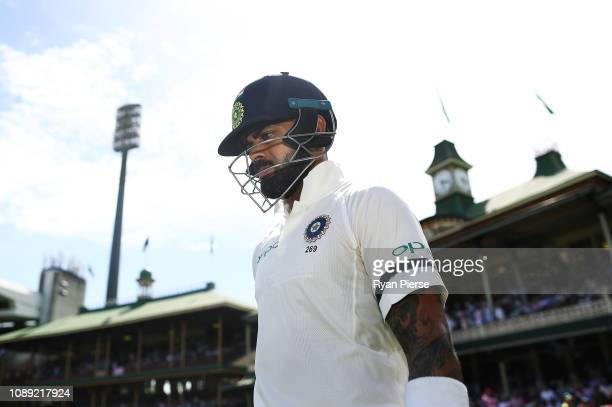 Virat Kohli of India walks out to bat during day one of the Fourth Test match in the series between Australia and India at Sydney Cricket Ground on...