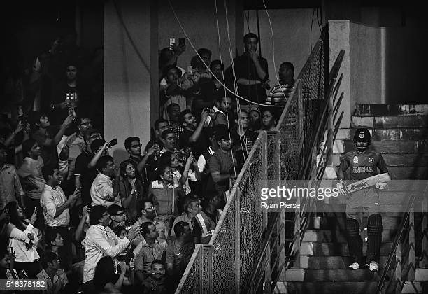 Virat Kohli of India walks out to bat during the ICC World Twenty20 India 2016 Semi Final match between West Indies and India at Wankhede Stadium on...