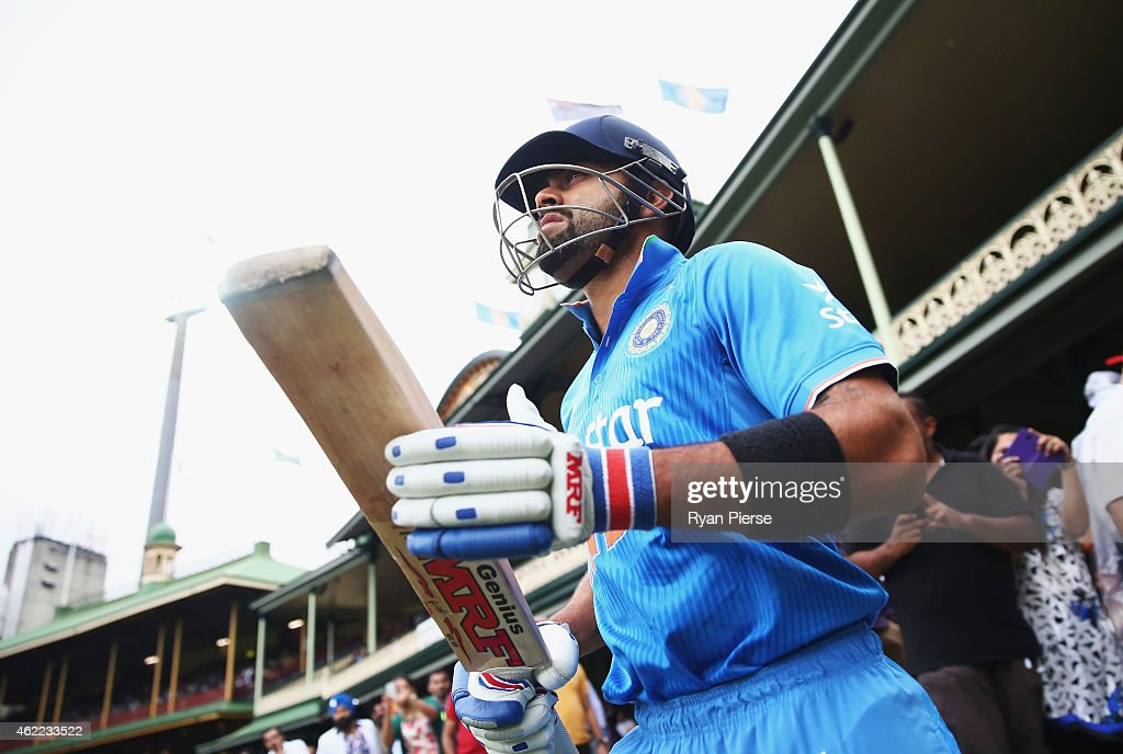Virat Kohli of India walks out to bat during the One Day International match between Australia and India at Sydney Cricket Ground on January 26, 2015 in Sydney, Australia.