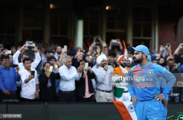 Virat Kohli of India walks out to field during the International Twenty20 match between Australia and India at Sydney Cricket Ground on November 25...