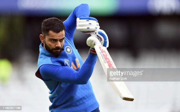 Virat Kohli of India warms up before the Group Stage match of the ICC Cricket World Cup 2019 between Sri Lanka and India at Headingley on July 06,...