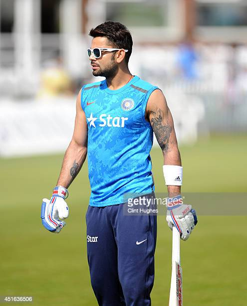 Virat Kohli of India warms up prior to play during day two of the tour match between Derbyshire and India at The 3aaa County Ground on July 2 2014 in...
