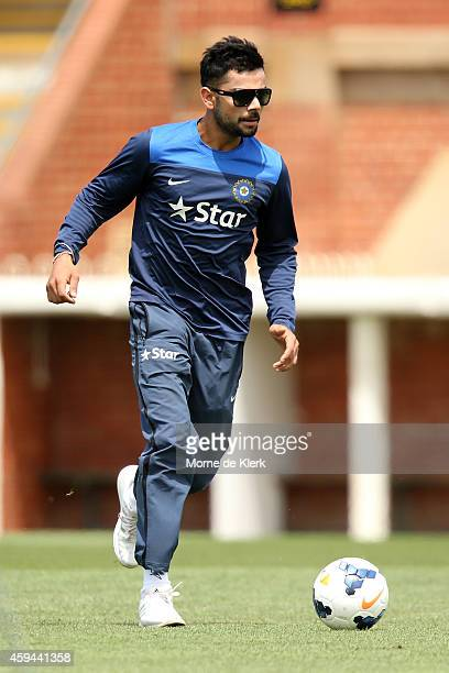 Virat Kohli plays a game of soccer to warm up during a training session for the Indian cricket team at Gliderol Stadium on November 23 2014 in...