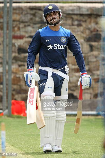 Virat Kohli stands in the nets during a training session for the Indian cricket team at Gliderol Stadium on November 23 2014 in Adelaide Australia