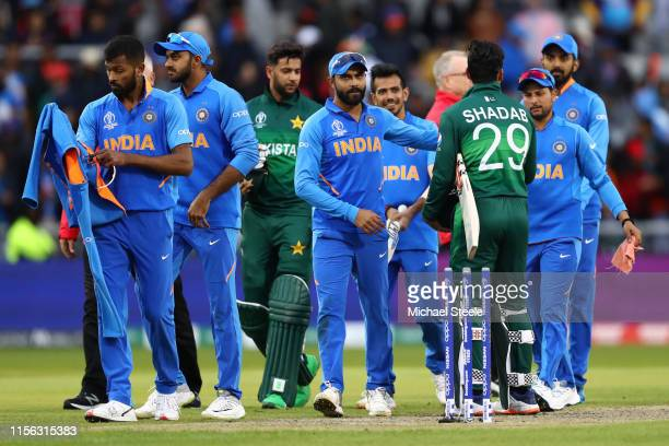 Virat Kohli the captain of India shakes hands with Shadab Khan of Pakistan after his side's 89 run win on D/L Method during the Group Stage match of...