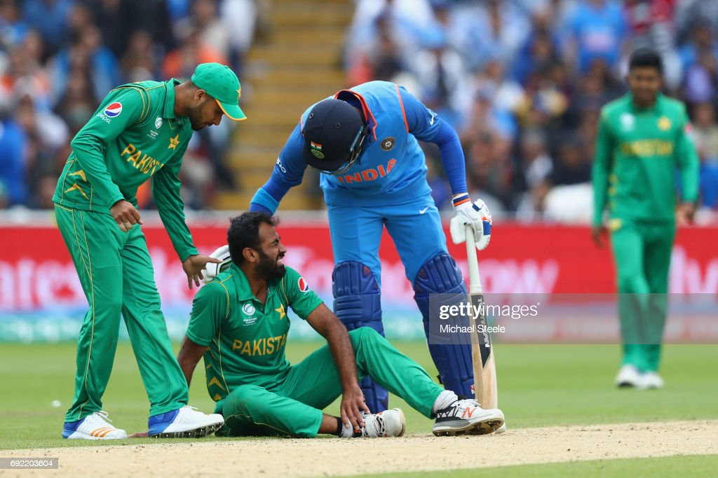 Image result for Wahab Riaz suffered a tournament-ending ankle injury during Pakistan's crushing 124-run defeat  against India
