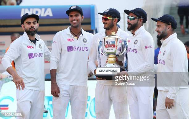 Virat Kohli, Washington Sundar, Axar Patel, Mohammed Siraj, Rishabh Pant of India pose with the Trophy after victory on Day Three of the 4th Test...