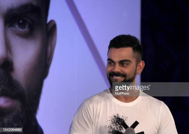Virat Kolhi an Indian international cricketer who currently captains the India national team during the unveiling of their special edition Tissot...