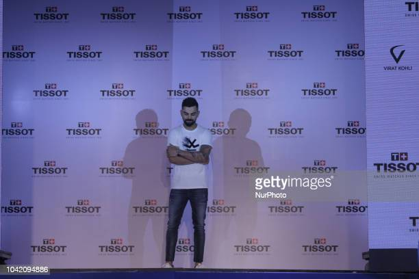 Virat Kolhi an Indian international cricketer who currently captains the India national team at the unveiling of their special edition Tissot CHRONO...