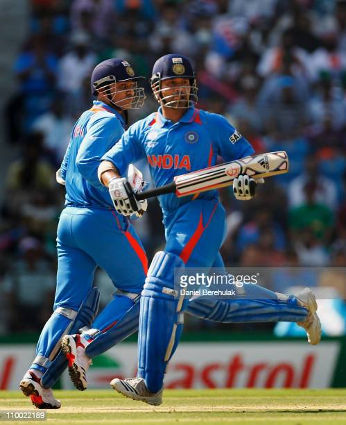 Virender Sehwag and Sachin Tendulkar of India run between wickets during the Group B ICC World Cup Cricket match between India and South Africa at...