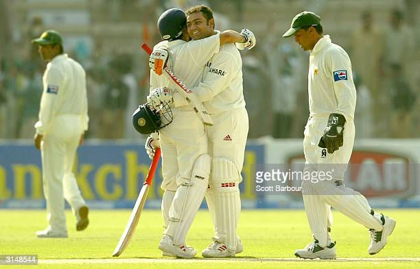 Virender Sehwag is hugged by Sachin Tendulkar of India after Sehwag reached his 200 during day one of the 1st Test Match between Pakistan and India...