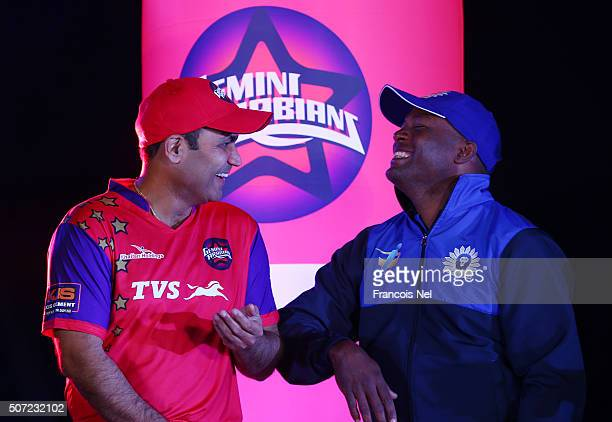 Virender Sehwag of Gemini Arabians shares a joke with Brian Lara of Leo Lions during the Opening Ceremony for the Oxigen Masters Champions League...