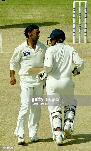 Virender Sehwag of India and Shoaib Akhtar of Pakistan run into each during day one of the 1st Test Match between Pakistan and India at Multan...