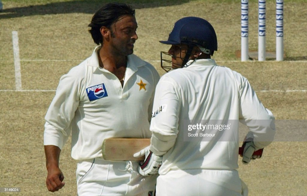 Virender Sehwag of India and Shoaib Akhtar of Pakistan run into each other as Sehwag completes a run during day 1 of the 1st Test Match between...