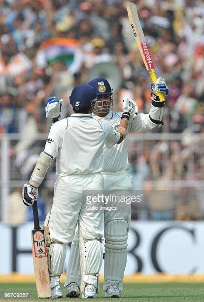 Virender Sehwag of India celebrates his 100 with Sachin Tendulkar during day two of the Second Test match between India and South Africa at Eden...