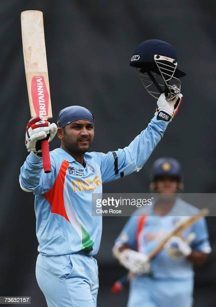 Virender Sehwag of India celebrates his century during the ICC Cricket World Cup 2007 Group B match between Bermuda and India at the Queens Park Oval...