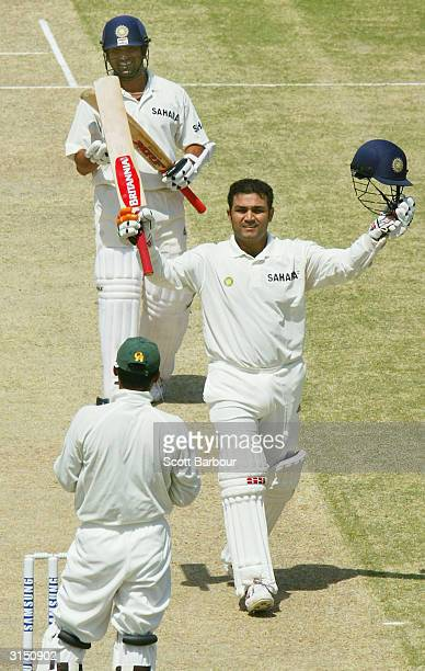 Virender Sehwag of India celebrates reaching his 300 as teammate Sachin Tendulkar applauds during day 2 of the 1st Test Match between Pakistan and...