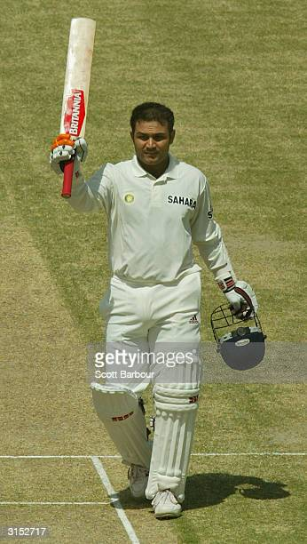 Virender Sehwag of India celebrates reaching his 300 during day 2 of the 1st Test Match between Pakistan and India at Multan Stadium on March 29,...