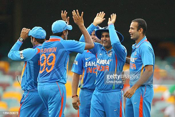Virender Sehwag of India celebrates with team mates after catching Mahela Jayawardena of Sri Lanka during game eight of the One Day International...