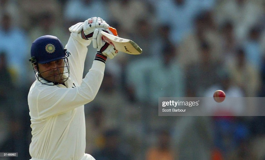 Virender Sehwag of India hits a boundary during day 1 of the 1st Test Match between Pakistan and India at Multan Stadium on March 28 2004 in Multan...