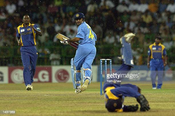 Virender Sehwag of India hits out as the rain begins during the India v Sri Lanka Final of the ICC Champions Trophy at the R Premadasa Stadium...