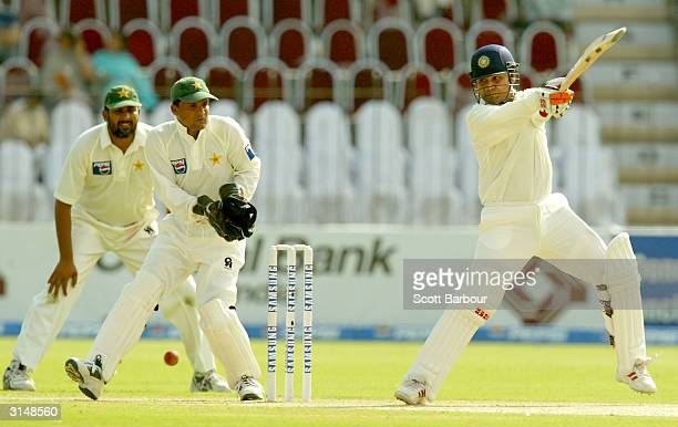 Virender Sehwag of India hits out during day one of the 1st Test Match between Pakistan and India at Multan Stadium on March 28 2004 in Multan...