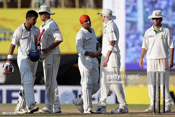 Virender Sehwag of India is congratulated by SA players on his 300 runs at the end of play during day 3 of the 1st test match between India and South...