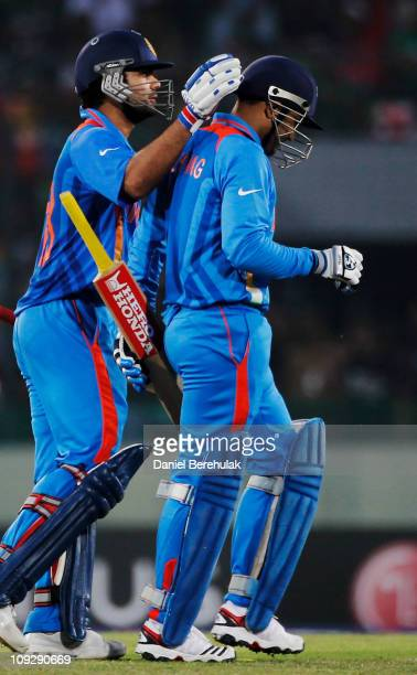Virender Sehwag of India is congratulated by team mate Virat Kohli after being dismissed for 175 runs during the opening game of the ICC Cricket...