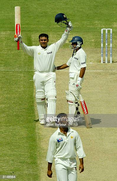 Virender Sehwag of India is congratulated by teammate Akash Chopra after completeing his century during day one of the 1st Test Match between...