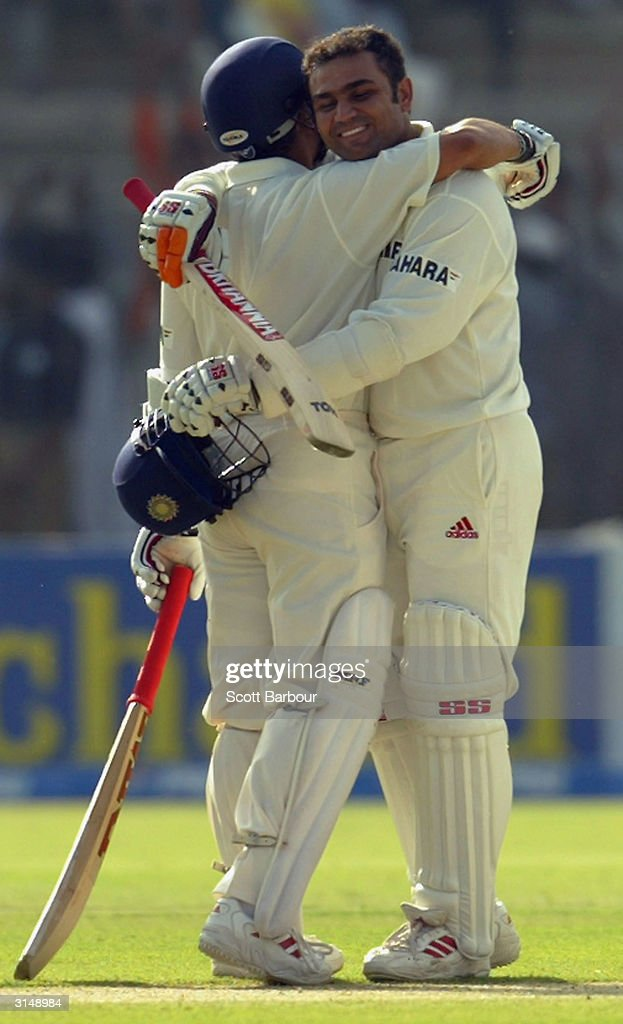 Virender Sehwag of India is hugged by Sachin Tendulkar after Sehwag reached his 200 during day 1 of the 1st Test Match between Pakistan and India at..