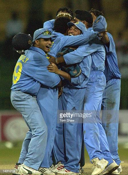 Virender Sehwag of India is mobbed by teammates with captain Sourav Ganguly on the right after beating South Africa during the South Africa v India...