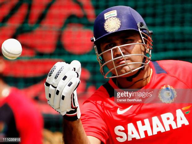 Virender Sehwag of India throws a ball back to the bowler during an Indian team training session at the PCA ground on March 29 2011 in Mohali India...
