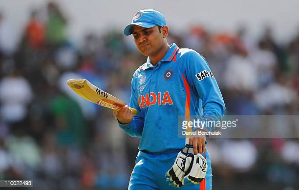 Virender Sehwag of India walks back to the pavillion after being bowled by Faf du Plessis of South Africa during the Group B ICC World Cup Cricket...