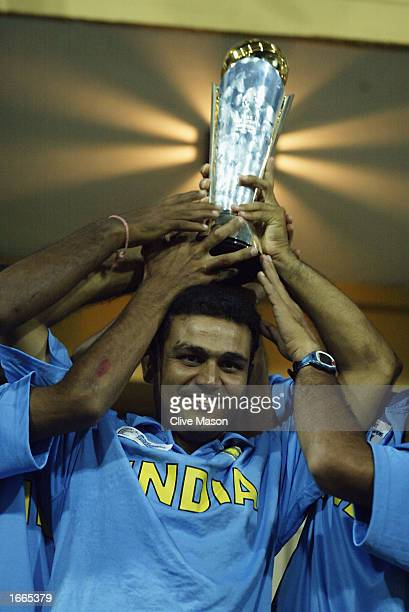 Virender Sehwag of India with the trophy after the rescheduled ICC Champions Trophy final between Sri Lanka and India at the R Premadasa Stadium in...