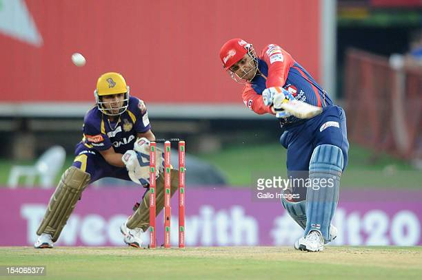 Virender Sehwag of the Daredevils bats as wicketkeeper Manvinder Bisla looks on during the Karbonn Smart CLT20 Group A match between Kolkata Knight...