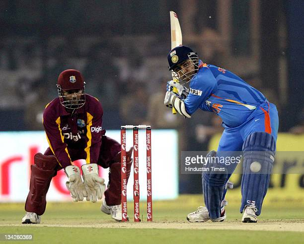 Virendra Sehwag of India gets in position to play a shot during the first One Day International match between India and West Indies at Barabati...
