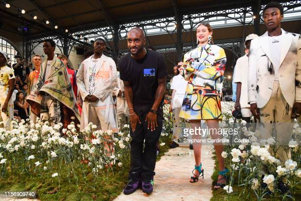 Virgil Abloh and Gigi Hadid greet the audience on the runway after the Off-White Menswear Spring Summer 2020 show as part of Paris Fashion Week on...