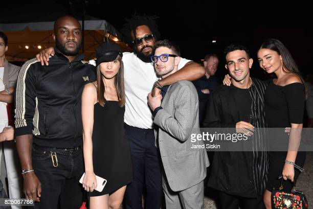 Virgil Abloh Leanna Jacobs Maxwell Osborne and Alex Soros guest and Merlot Margurite attend The 24th Annual Watermill Center Summer Benefit Auction...