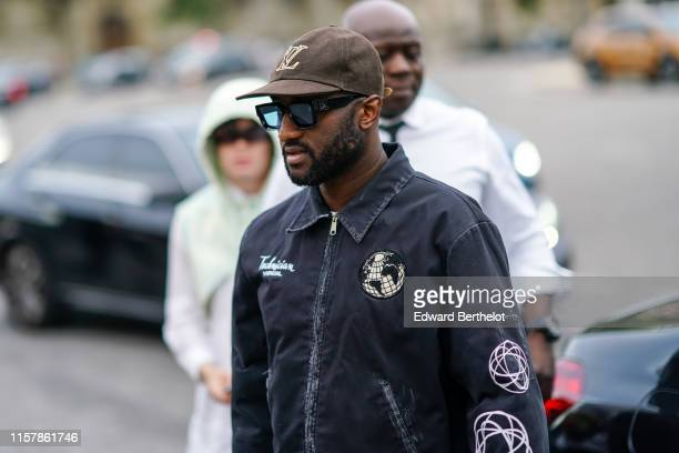 Virgil Abloh wears a brown Vuitton cap, a jacket with patches, outside Celine, during Paris Fashion Week - Menswear Spring/Summer 2020, on June 23,...