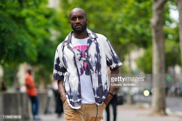 Virgil Abloh wears a white t-shirt with a picture print, a tie and dye black and white shirt, outside Heron Preston, during Paris Fashion Week -...