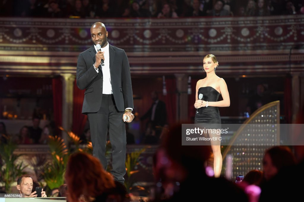 Virgil Abloh (L) winner of the Urban Luxe award and Hailey Baldwin (R) on stage during The Fashion Awards 2017 in partnership with Swarovski at Royal Albert Hall on December 4, 2017 in London, England.