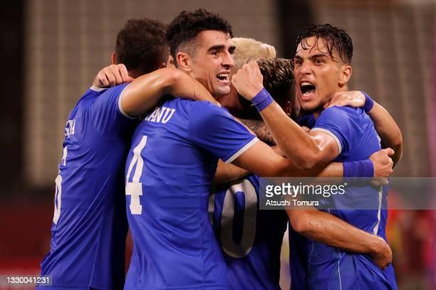 Virgil Ghita, Alexandru Pascanu, and Andrei Ciobanu of Team Romania celebrate their side's first goal, an own goal by Elvin Oliva of Team Honduras...