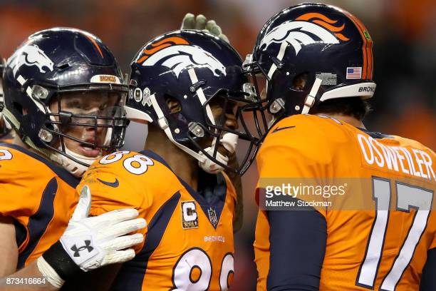 Virgil Green of the Denver Broncos celebrates a touchdown with Garrett Bolles and Brock Osweiler against the New England Patriots at Sports Authority...