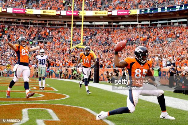 Virgil Green of the Denver Broncos celebrates after scoring a touchdown against the Dallas Cowboys at Sports Authority Field at Mile High on...