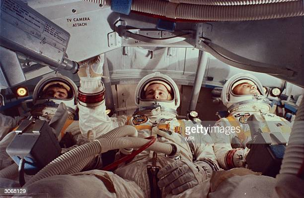 Virgil I Grissom Edward White and Roger Chaffee inside a practice module for the aborted Apollo 1 mission at Cape Kennedy Florida All three men were...