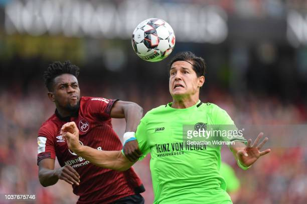 Virgil Misidjan of Nuernberg and Miiko Albornoz of Hannover compete for the ball during the Bundesliga match between 1. FC Nuernberg and Hannover 96...