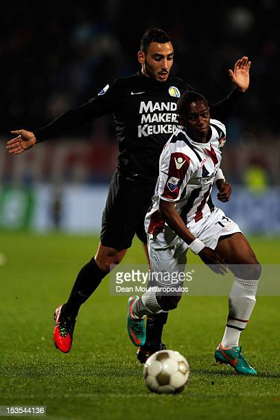Virgil Misidjan of Willem II and Imad Najah of RKC battle for the ball during the Eredivisie match between Willem II Tilburg and RKC Waalwijk at the...
