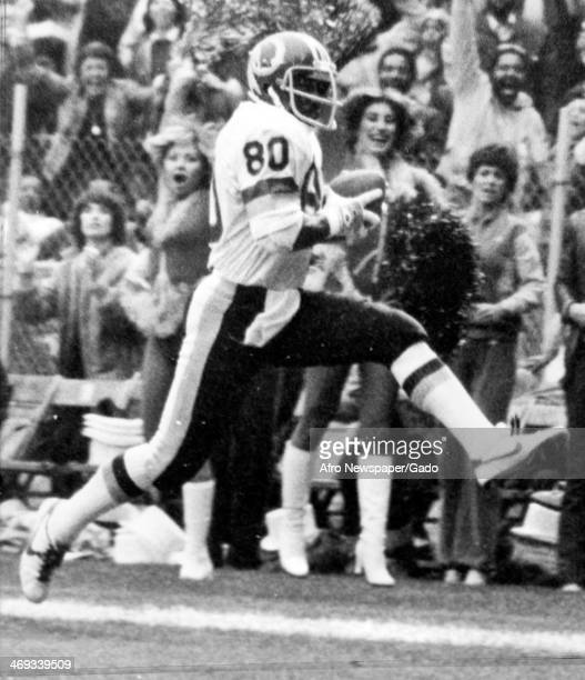 Virgil Seay wide receiver for the Washington Redskins high steps at the Cardinal 10 yard line on his way to a 51 yard pass for second touchdown...