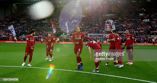 Virgil van Dijk and Adam Lallana of Liverpool at the start of the Premier League match between Liverpool FC and Cardiff City at Anfield on October 27...