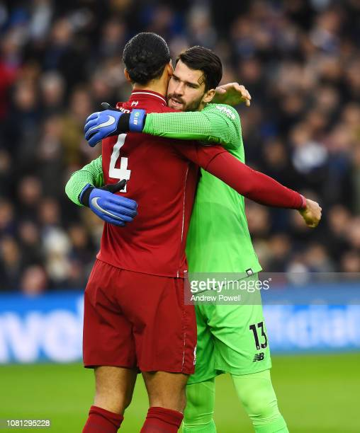 Virgil Van Dijk and Alisson Becker of Liverpool before the Premier League match between Brighton Hove Albion and Liverpool FC at American Express...